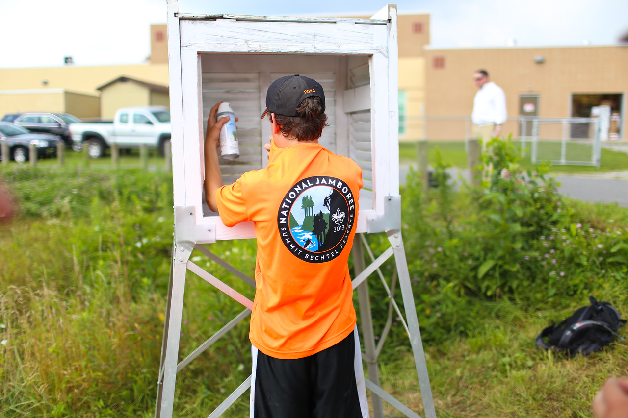 Boy Scout painting at a community garden service project in West Virginia. Corporation for National and Community Service Photo.