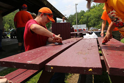 Boy Scouts re-surfacing a park bench in West Virginia.Corporation for National and Community Service Photo.