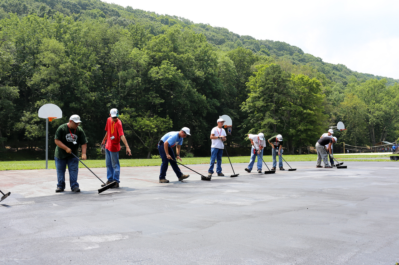 Boy Scouts re-tarring a basketball court in West Virginia. Corporation for National and Community Service Photo.