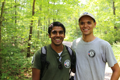AmeriCorps NCCC team leader and AmeriCorps member serving alongside boy scouts during the Boy Scout Jamboree in West Virginia. Corporation for National and Community Service Photo.