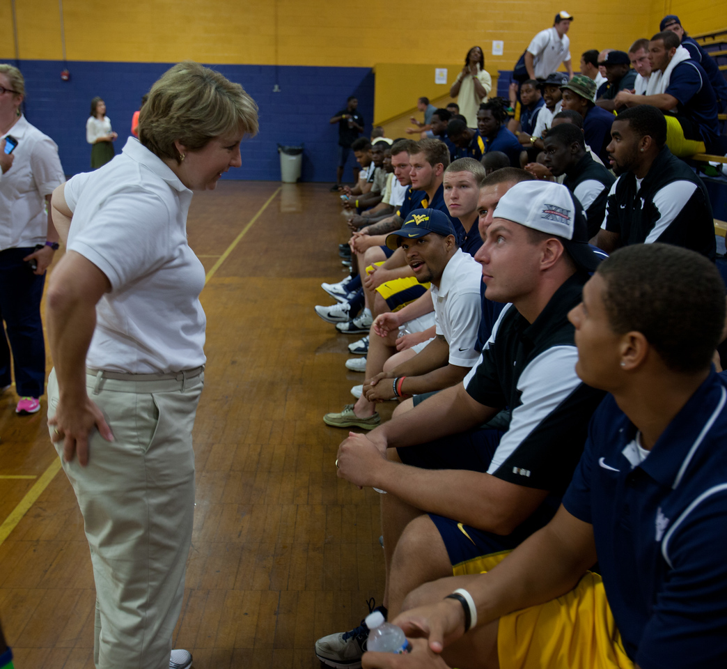 CNCS CEO, Wendy Spencer speaking to WVU football team and volunteers at a service project.Corporation for National and Community Service Photo.