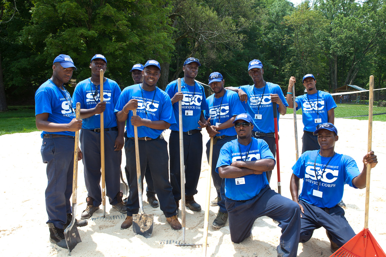 AmeriCorps Service Corps members serving to re-surfacing a volley ball court in a park in West Virginia. Corporation for National and Community Service Photo.