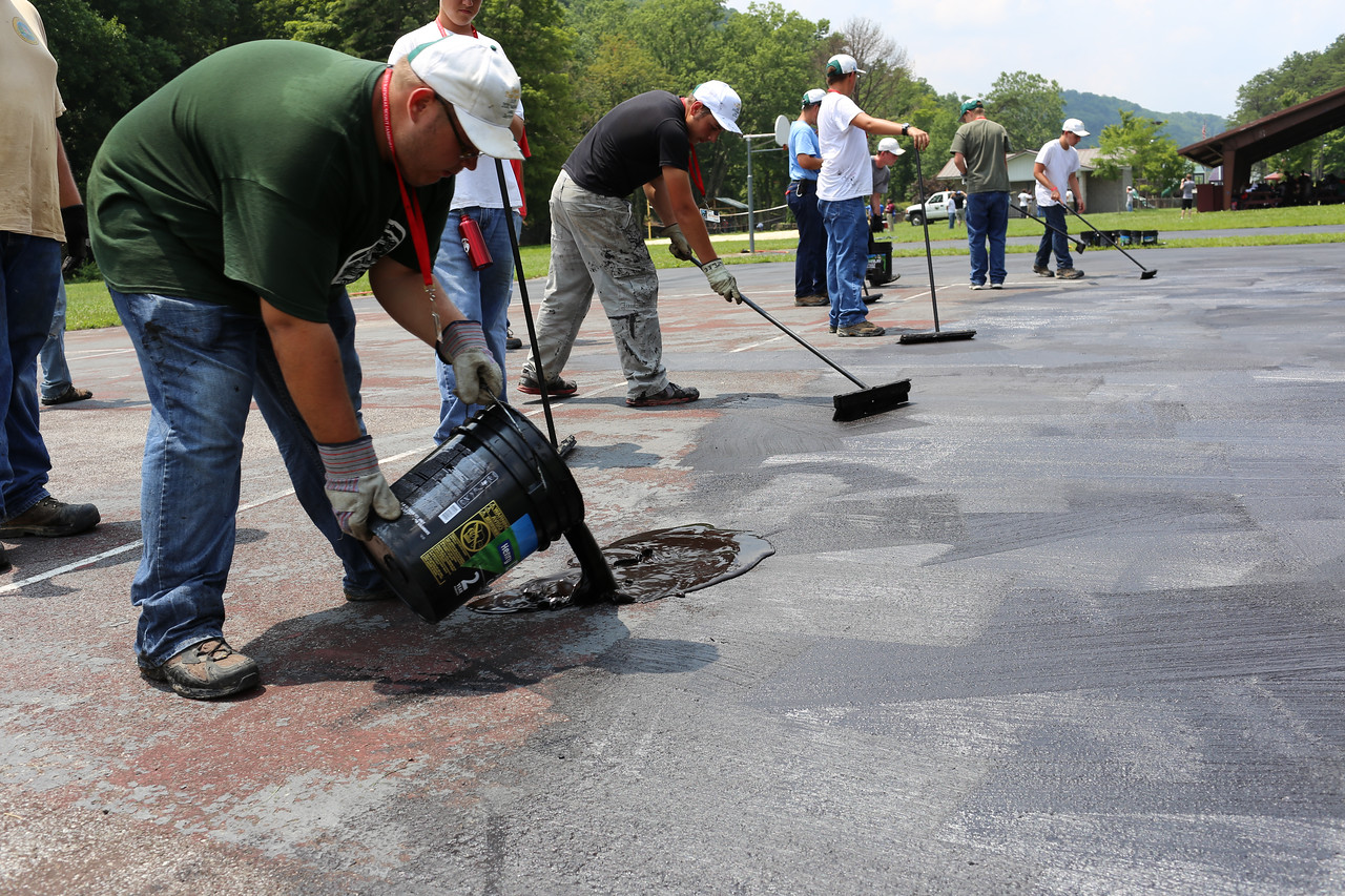 Boy Scouts re-tarring a basketball court in West Virginia.Corporation for National and Community Service Photo.