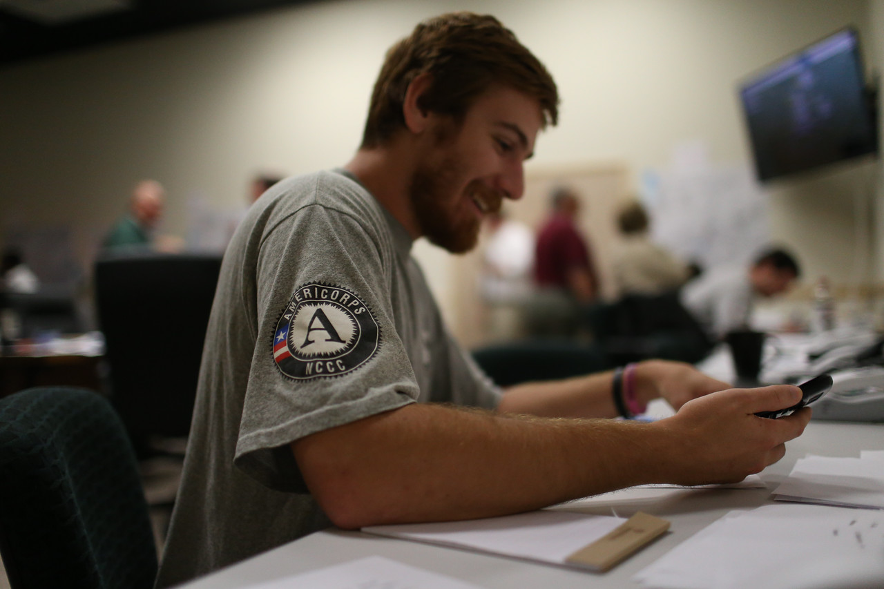 AmeriCorps NCCC member communicating with volunteers across counties in West Virginia.Corporation for National and Community Service Photo.