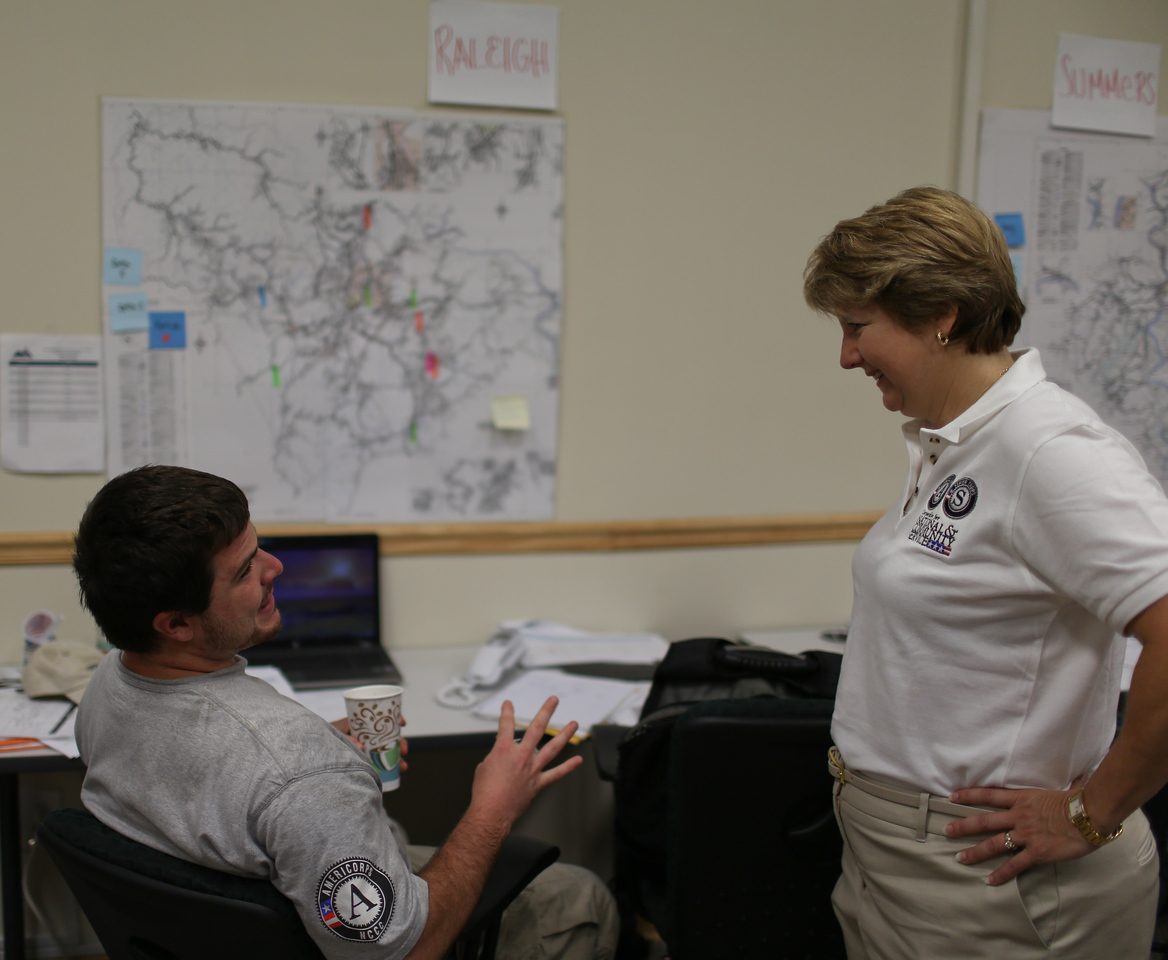 AmeriCorps NCCC member speaking with CNCS CEO, Wendy Spencer about service project logistics in West Virginia during the Boy Scouts Jamboree. Corporation for National and Community Service Photo.