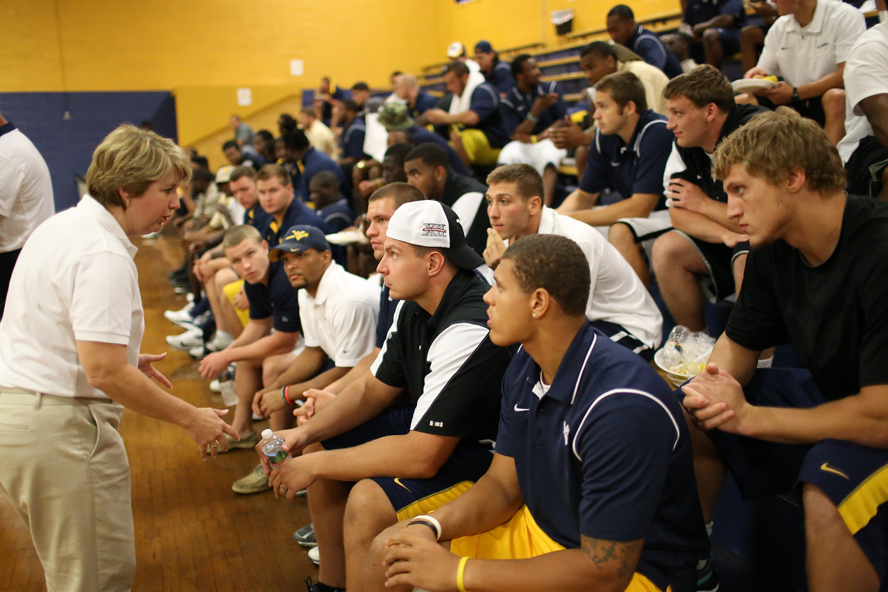 CNCS CEO, Wendy Spencer speaks with West Virginia University Football team members during lunch in between service projects. Corporation for National and Community Service Photo.