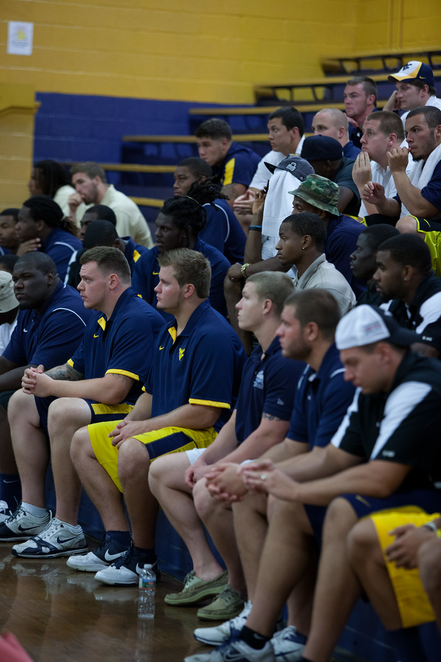 WVU football team and boy scouts at a service project.Corporation for National and Community Service Photo.