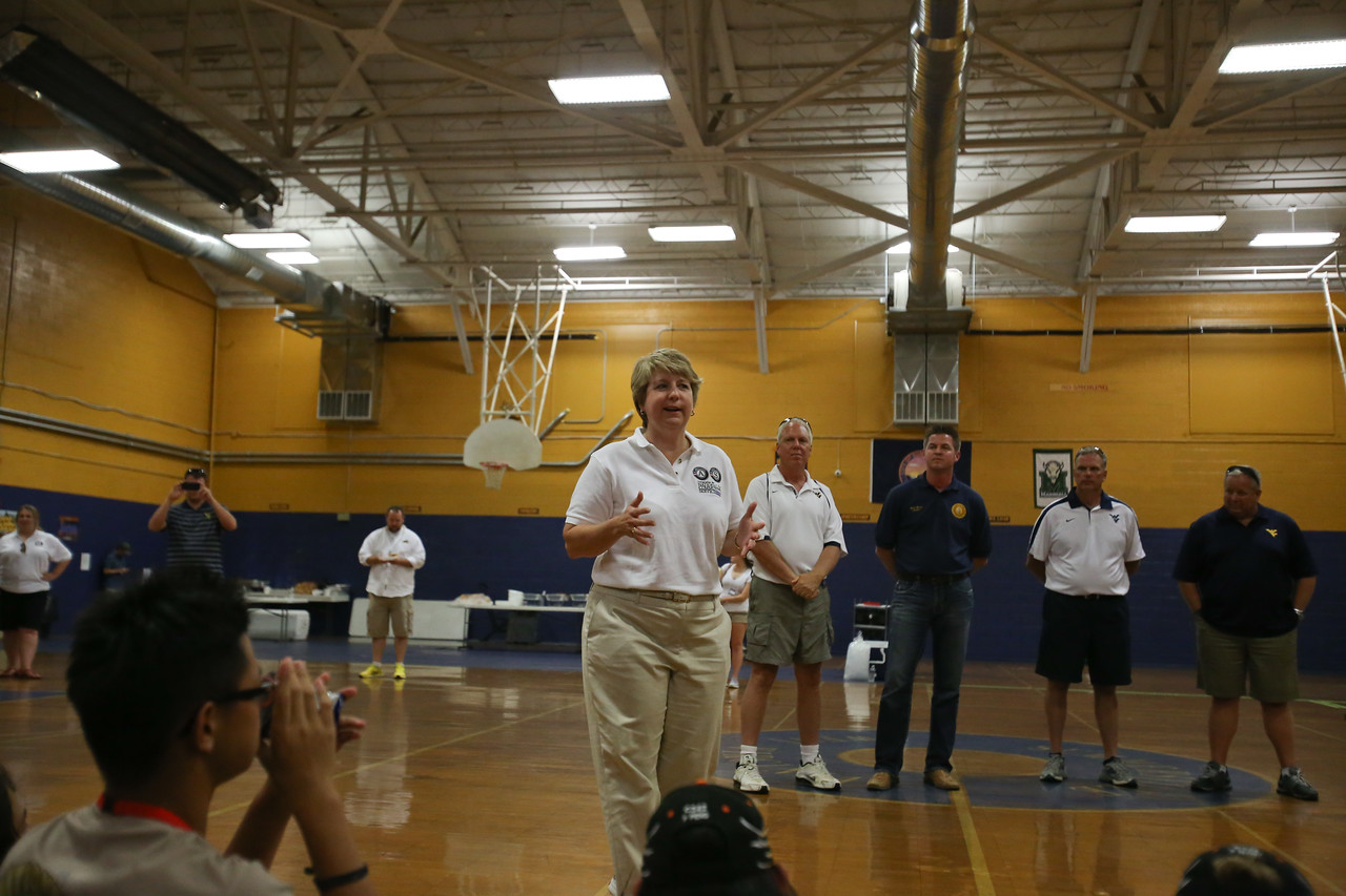 CNCS CEO, Wendy Spencer speaks to Boy Scouts and WVU football team at a gym where volunteers participated in service in Summersville, WV. Corporation for National and Community Service Photo.