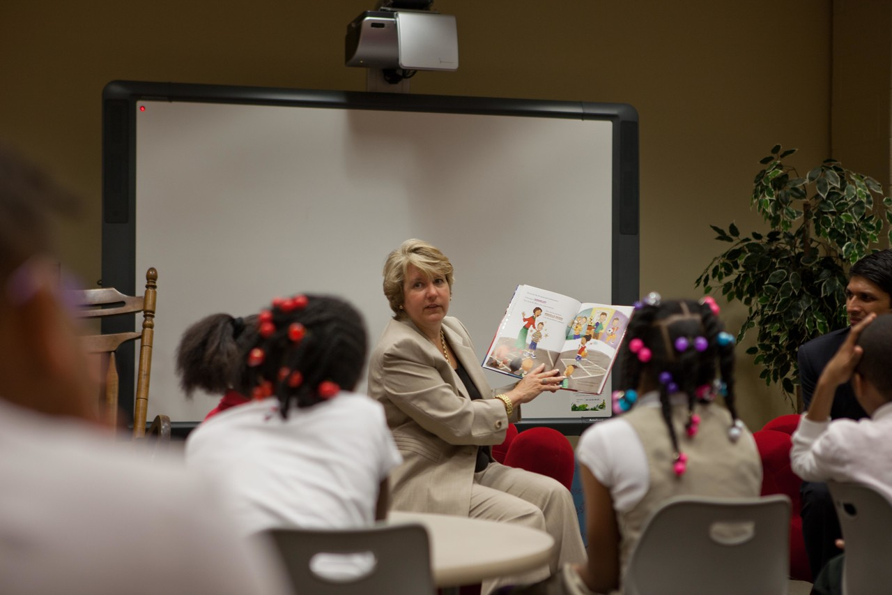 Corporation for National and Community Service, CEO Wendy Spencer reads to children at Burrville Elementary. Corporation for National and Community Service Photo.