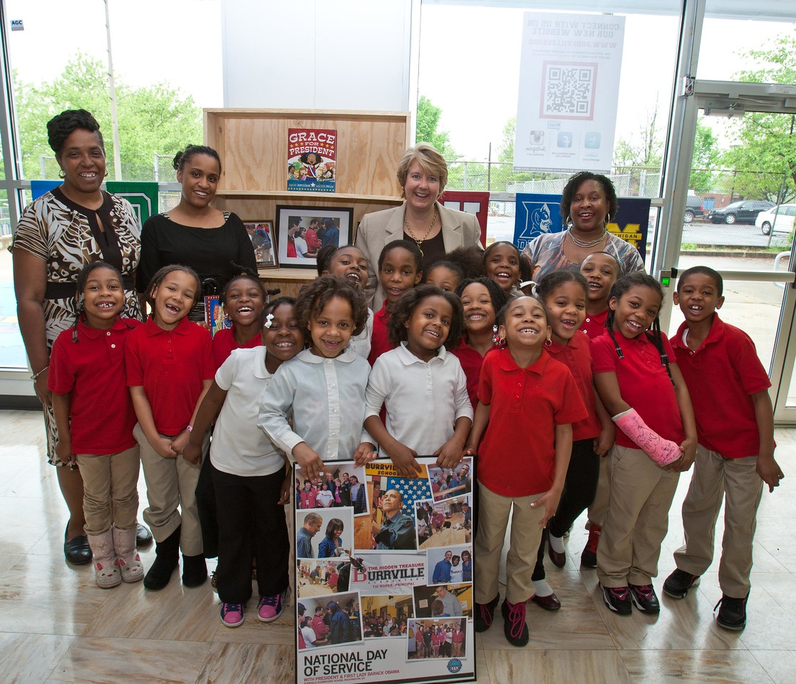 Students from Burrville Elementary pose for a picture with Principal, Tui J. Roper and Corporation for National and Community Service, CEO Wendy Spencer. Corporation for National and Community Service Photo.