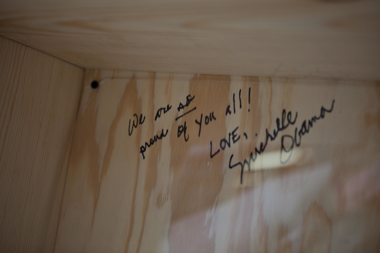 First Lady Michelle Obama's signature on the bookshelf she helped build at Burrville Elementary for the MLK Day of service 2013.Corporation for National and Community Service Photo.