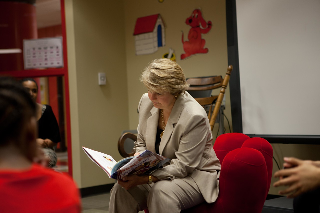 Corporation for National and Community Service, CEO Wendy Spencer reads a book to children at Burrville Elementary. Corporation for National and Community Service Photo.