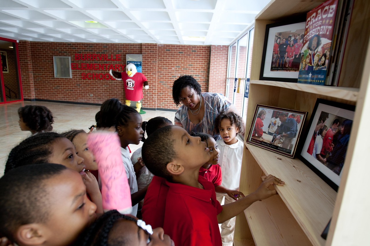 Students add books to the bookshelf that was built on MLK Day by President Obama, First Lady Michelle Obama and Corporation for National and Community Service, CEO Wendy Spencer. Corporation for National and Community Service Photo.