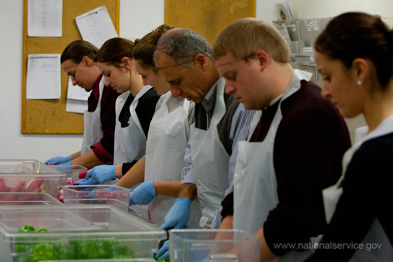 AmeriCorps Director John Gomperts and volunteers preparing food at DC Central Kitchen. Corporation for National and Community Service Photo.