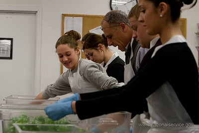 AmeriCorps Director John Gomperts and volunteers prepare food at the DC Central Kitchen in December 2011. (Corporation for National and Community Service photo)