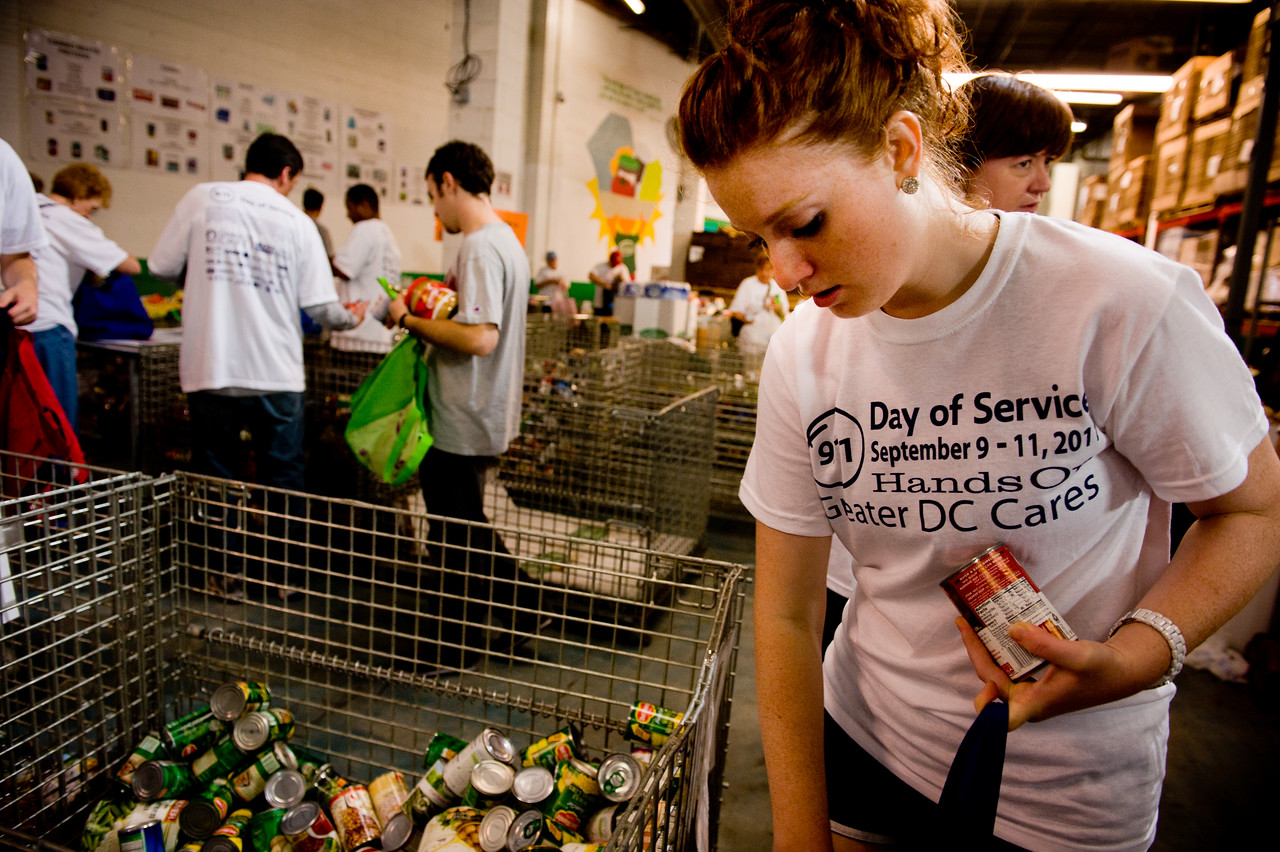 A volunteer sorts cans at the Capital Area Food Bank in Washington, DC, during the 9/11 Day of Service in September 2001. (Corporation for National and Community Service photo)