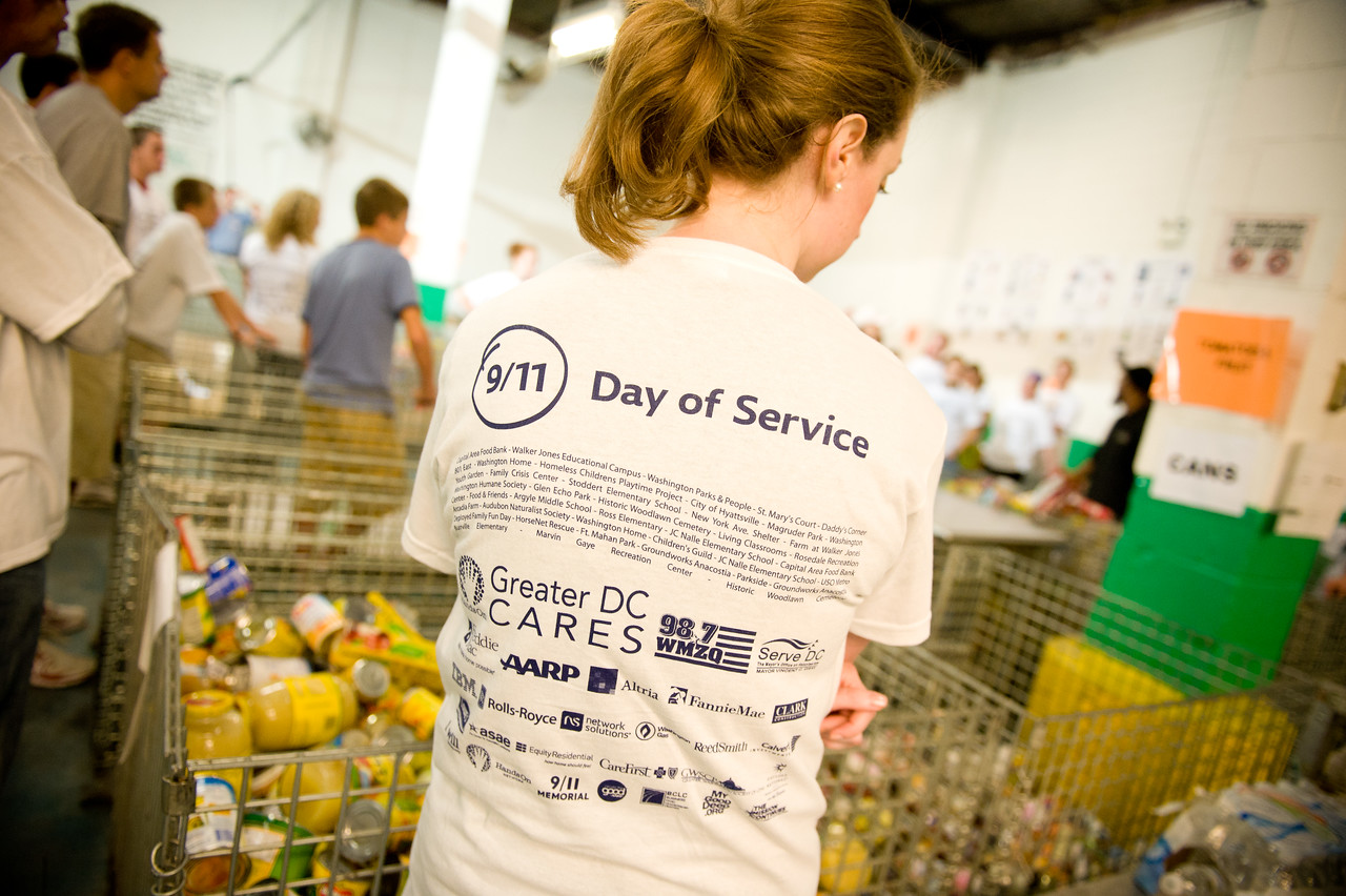 A volunteer listens to instructions at a food bank in Washington, DC, during the 2011 9/11 National Day of Service and Remembrance. Corporation for National and Community Service Photo.