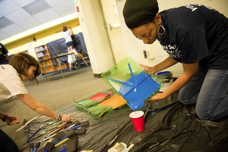 Volunteers prepare painting supplies for a wall mural in the library of West Education Campus, a K - 8 public school in Washington, DC. The volunteers were at the school as part of a September 11th National Day of Service and Remembrance event organized by HandsOn Greater DC Cares and U.S. Vets -- United States Veterans Initiative. The event was attended by over 200 White House and Corporation for National and Community Staff and their families. (Corporation photo by Sam Kittner, 2011)