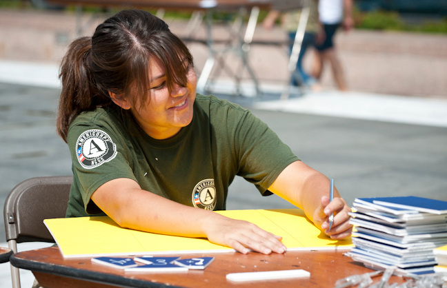 An AmeriCorps NCCC member creates math puzzles for local students at a September11th National day of Service and Remembrance service fair. The event was organized by Serve DC and Greater DC Cares as a Tribute to Service: Honoring the Victims, Survivors, and Heroes of 9/11. (Corporation photo by Steven E. Purcell, 2011)