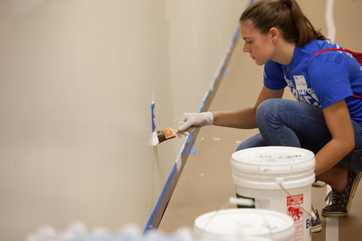 A volunteer paints at the 9/11 Day of Service at the D.C. Fire and EMS training facility.  Corporation for National and Community Service Photo.