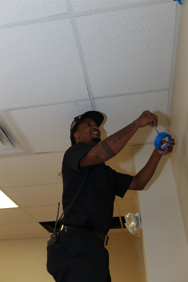D.C. Firefighter painting at the 9/11 Day of Service at the D.C. Fire and EMS training facility. Corporation for National and Community Service Photo