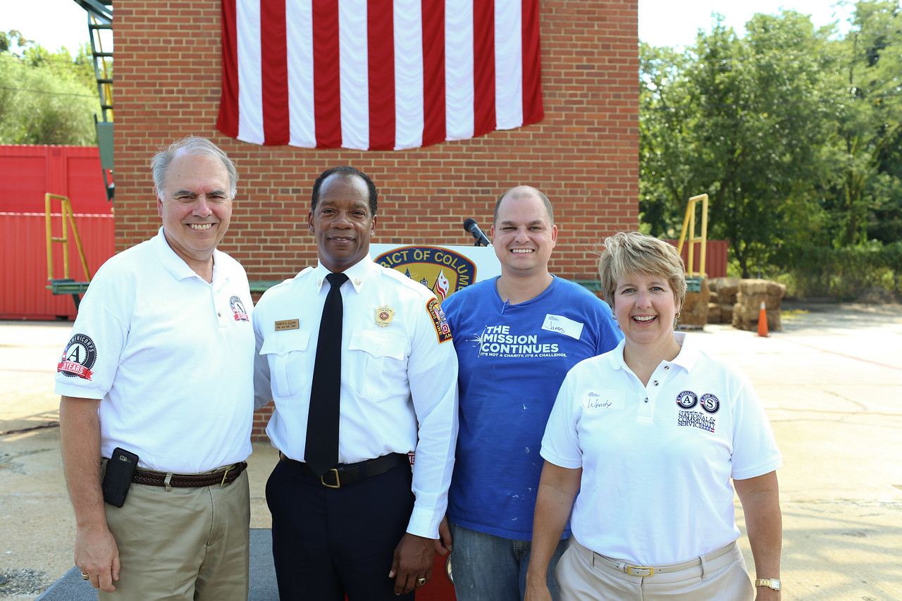 Director of AmeriCorps, Bill Basl, D.C. Fire Chief, Kenneth Ellerbe, Service Projects Associate, The Mission Continues, James Casey, CNCS CEO, Wendy Spencer. Corporation for National and Community Service Photo.