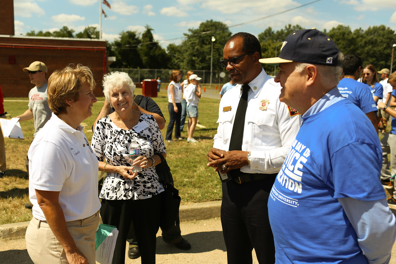 CNCS CEO, Wendy Spencer, D.C. Fire Chief. Kenneth Ellerbe and GWU President, Dr. Steven Knapp at the 9/11 Day of Service at the D.C. Fire and EMS training facility. Corporation for National and Community Service Photo.