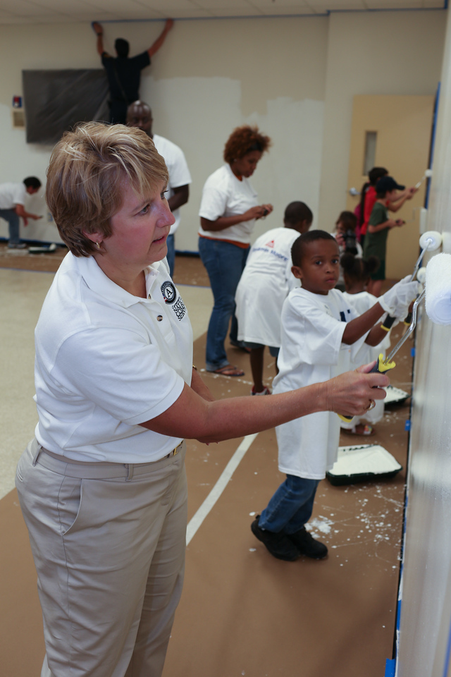 CNCS CEO, Wendy Spencer serving with volunteers painting at the 9/11 Day of Service at the D.C. Fire and EMS training facility. Corporation for National and Community Service Photo.