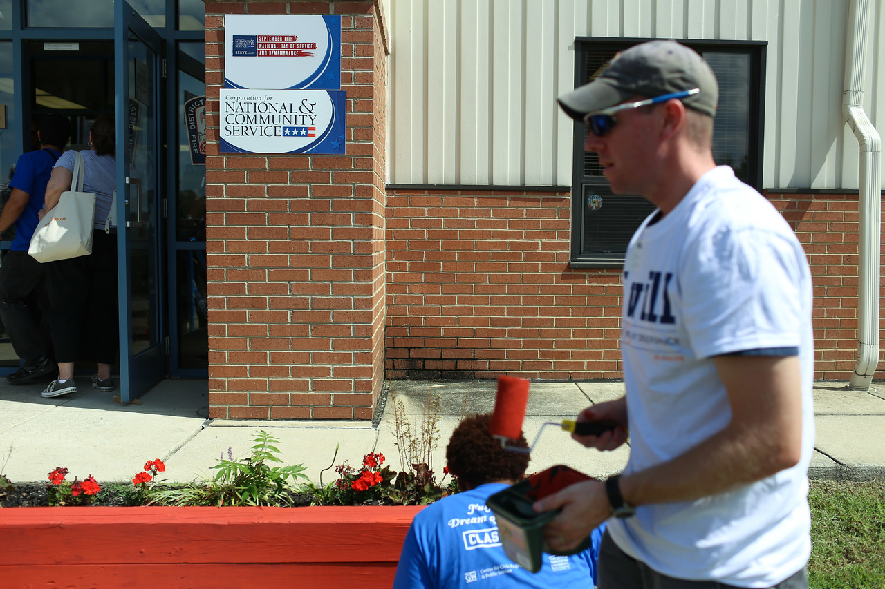 volunteer painting at the 9/11 Day of Service at the D.C. Fire and EMS training facility. Corporation for National and Community Service Photo.