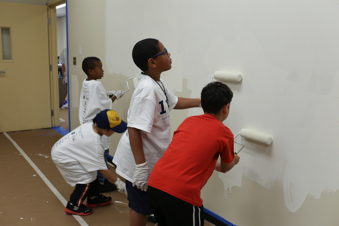 Volunteers painting at the 9/11 Day of Service at the D.C. Fire and EMS training facility. Corporation for National and Community Service Photo.