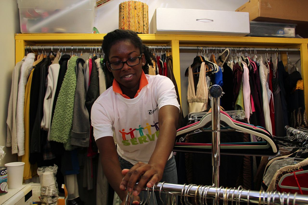 A volunteer sorts donated clothing at Martha's Table in Washington, D.C. on the September 11th National Day of Service and Remembrance. Corporation for National and Community Service Photo.