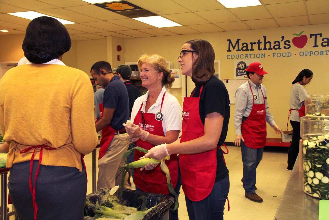 Kim Allman, Director of Government Relations at CNCS, serves alongside AmeriCorps members and volunteers at Martha's Table in Washington, D.C. on the September 11th National Day of Service and Remembrance. Corporation for National and Community Service Photo.Corporation for National and Community Service Photo.