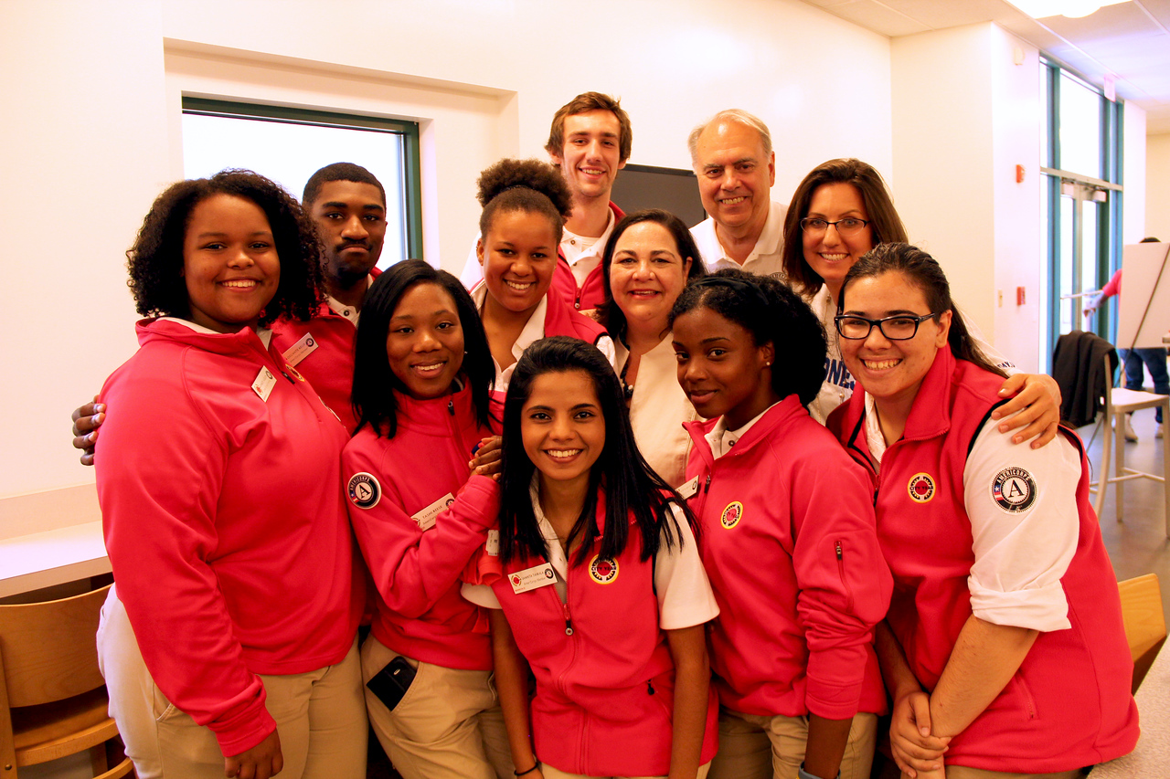 Administrator Marie Terese Dominguez from the U.S. Department of Transportation with Director of AmeriCorps Bill Basl and City Year AmeriCorps members at the Capital Area Food Bank in Washington, D.C. on the September 11th National Day of Service and Remembrance. Corporation for National and Community Service Photo.
