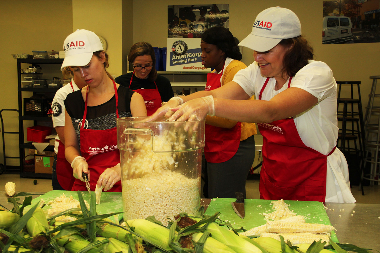 Carla Koppell, Chief Strategy Officer of USAID, serves alongside AmeriCorps members and volunteers at Martha's Table in Washington, D.C. on the September 11th National Day of Service and Remembrance. Corporation for National and Community Service Photo.