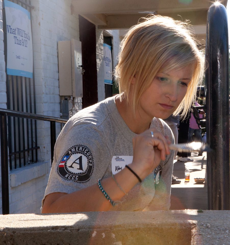 AmeriCorps member painting on 9/11 Day of Service and Remembrance in Washington, D.C. Corporation for National and Community Service Photo.