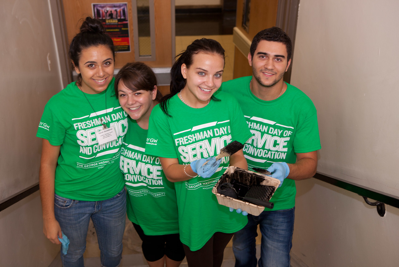 George Washington University students participate in a painting project on the Freshman Day of Service during the 2013 September 11th Day of Service and Remembrance. (Corporation for National and Community Service photo)