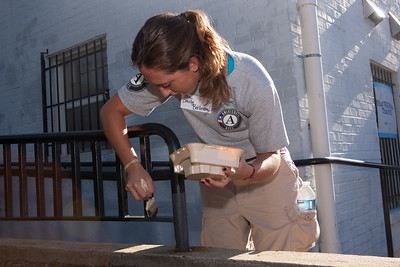 AmeriCorps member painting a railing. Corporation for National and Community Service Photo.
