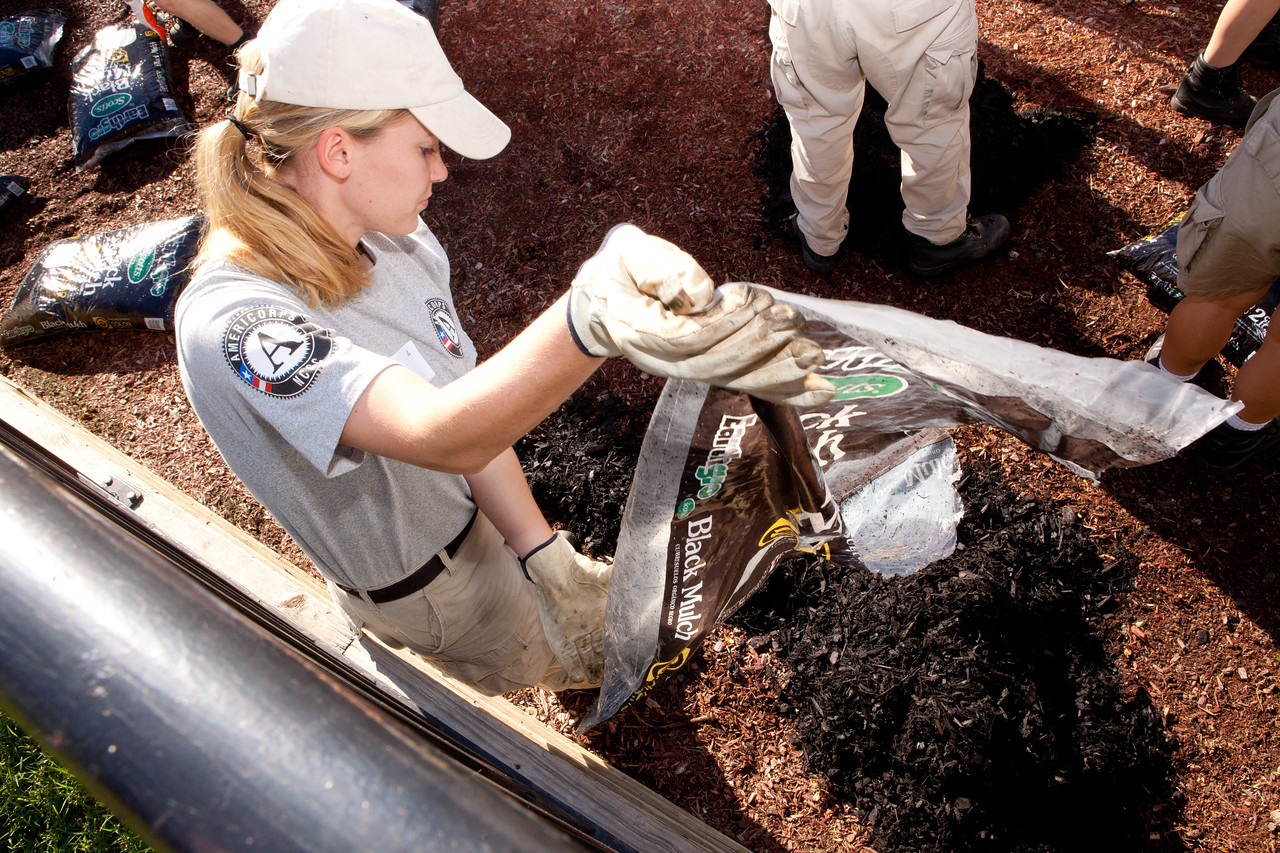 AmeriCorps member mulching a playground in Washington, D.C. Corporation for National and Community Service Photo.