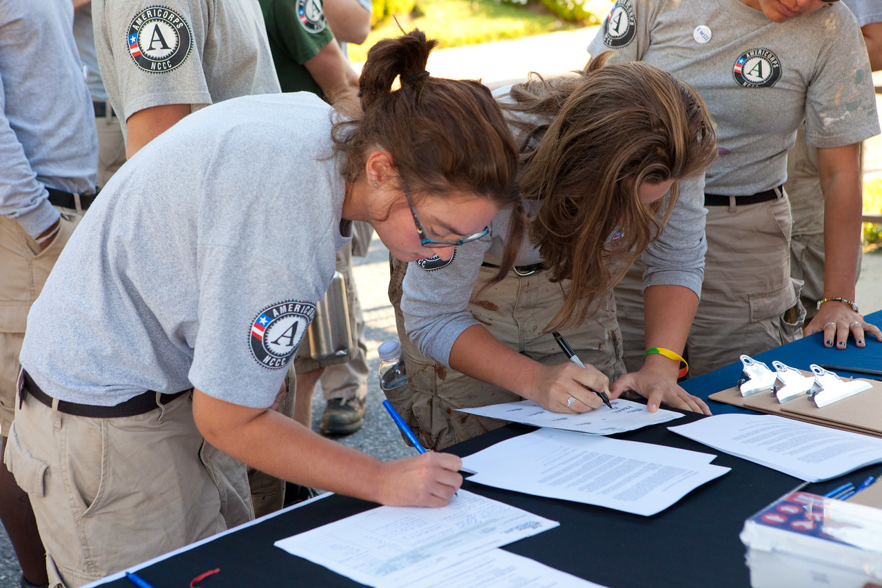 AmeriCorps member signing waivers at the 9/11 service event at Eastern apartments in Washington, D.C. Corporation for National and Community Service Photo.