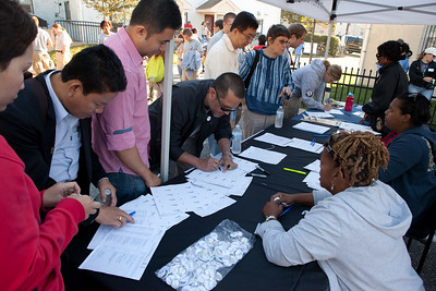 Volunteers signing waivers at a 2012 9/11 National Day of Service event in Washington, DC. (Corporation for National and Community Service photo)