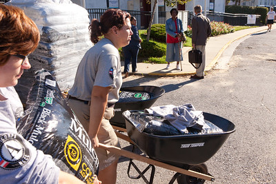 AmeriCorps members moving mulch to refurbish a playground. Corporation for National and Community Service Photo.