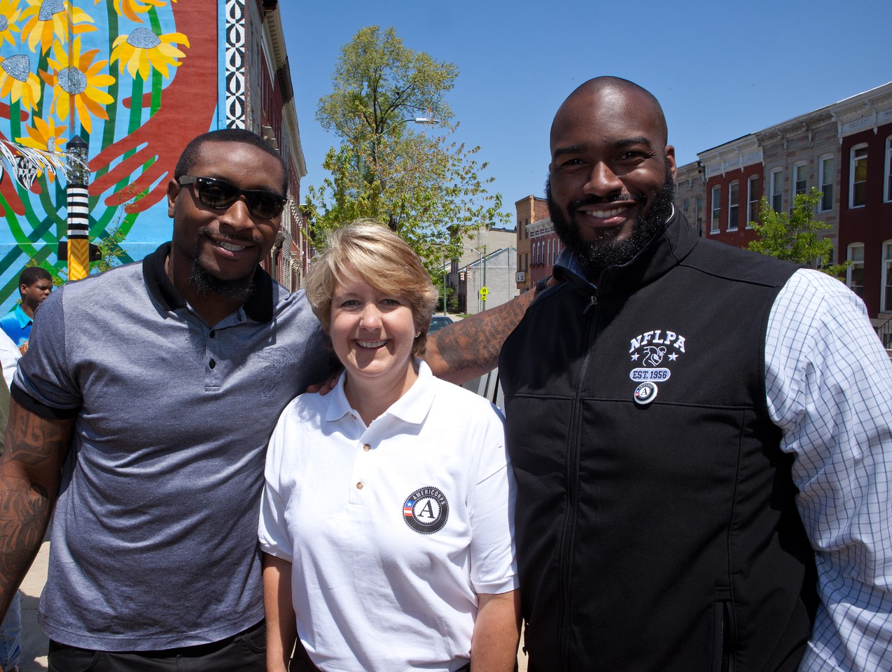 CNCS CEO Wendy Spencer poses with San Francisco 49ers linebacker Navorro Bowman and Joe Briggs of the NFL Players Association at the Service Bowl in Baltimore, MD. Corporation for National and Community Service Photo.