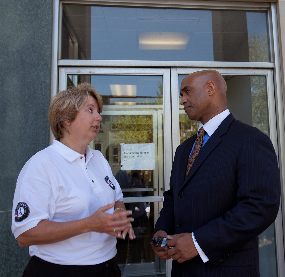 CNCS CEO Wendy Spencer speaks to a police official at a West Baltimore Police precinct at the Service Bowl in Baltimore, MD. Corporation for National and Community Service Photo.
