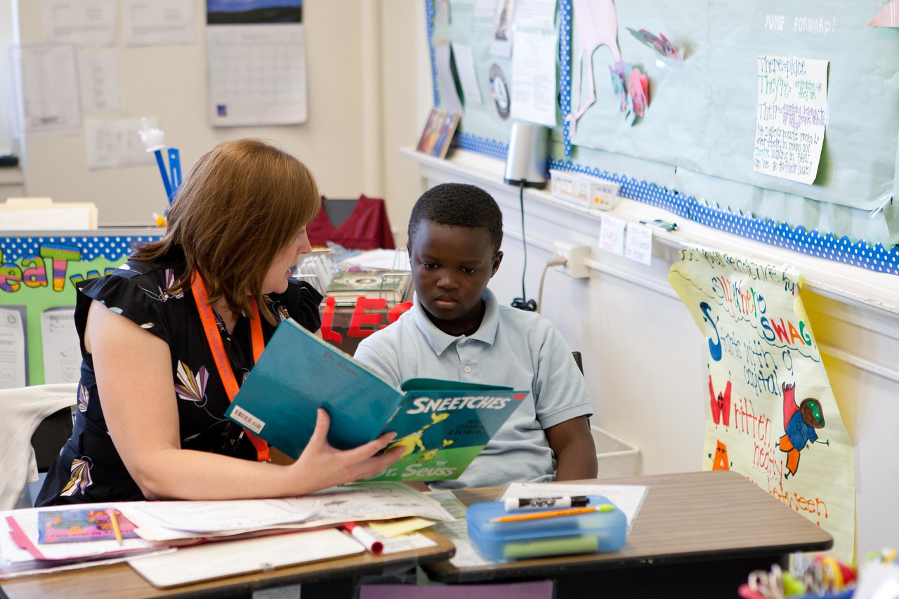 A volunteer reads to a young student at the Service Bowl in Baltimore, MD. Corporation for National and Community Service Photo.