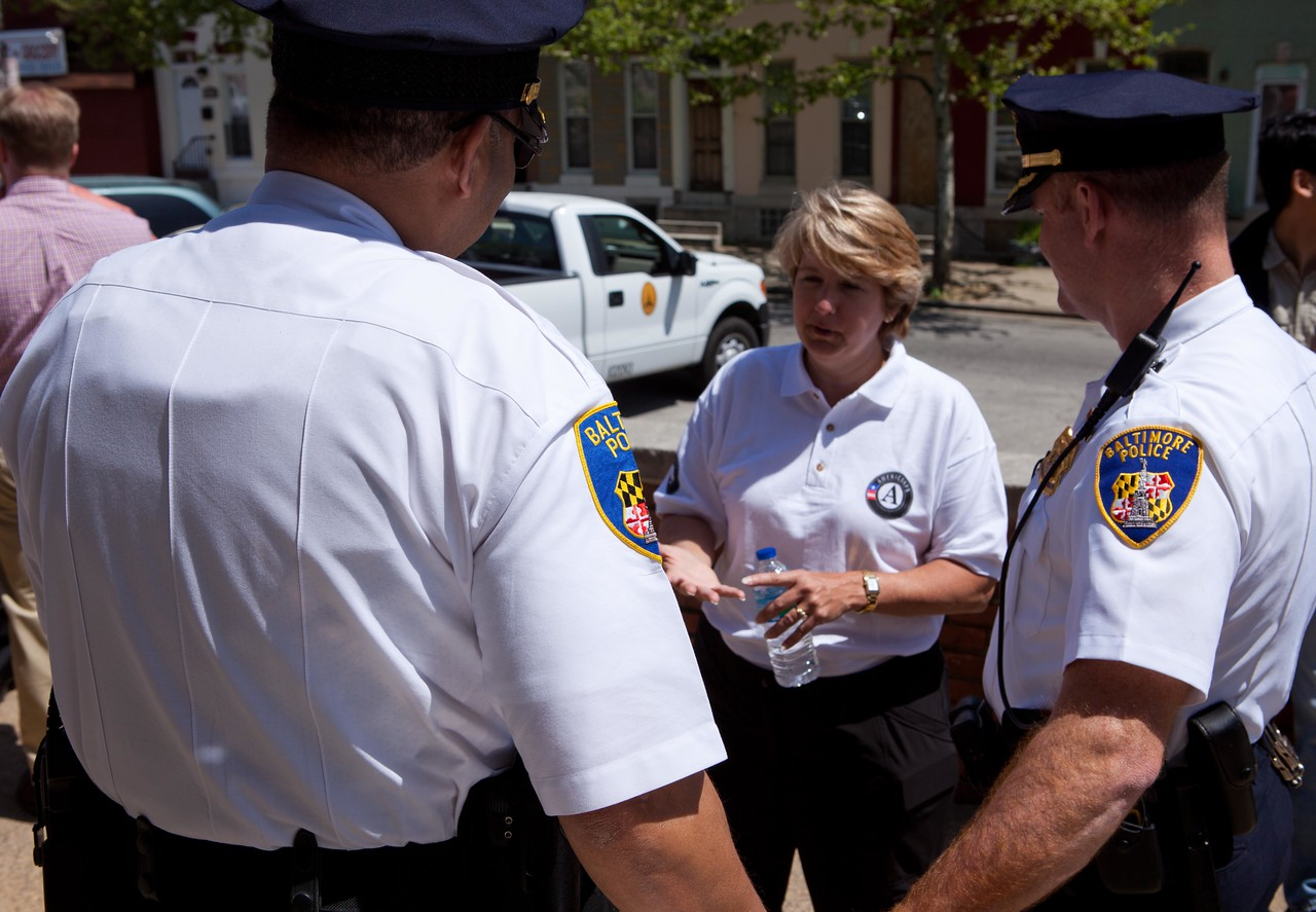 CNCS CEO Wendy Spencer speaks with Baltimore police officers at the Service Bowl in Baltimore, MD. Corporation for National and Community Service Photo.