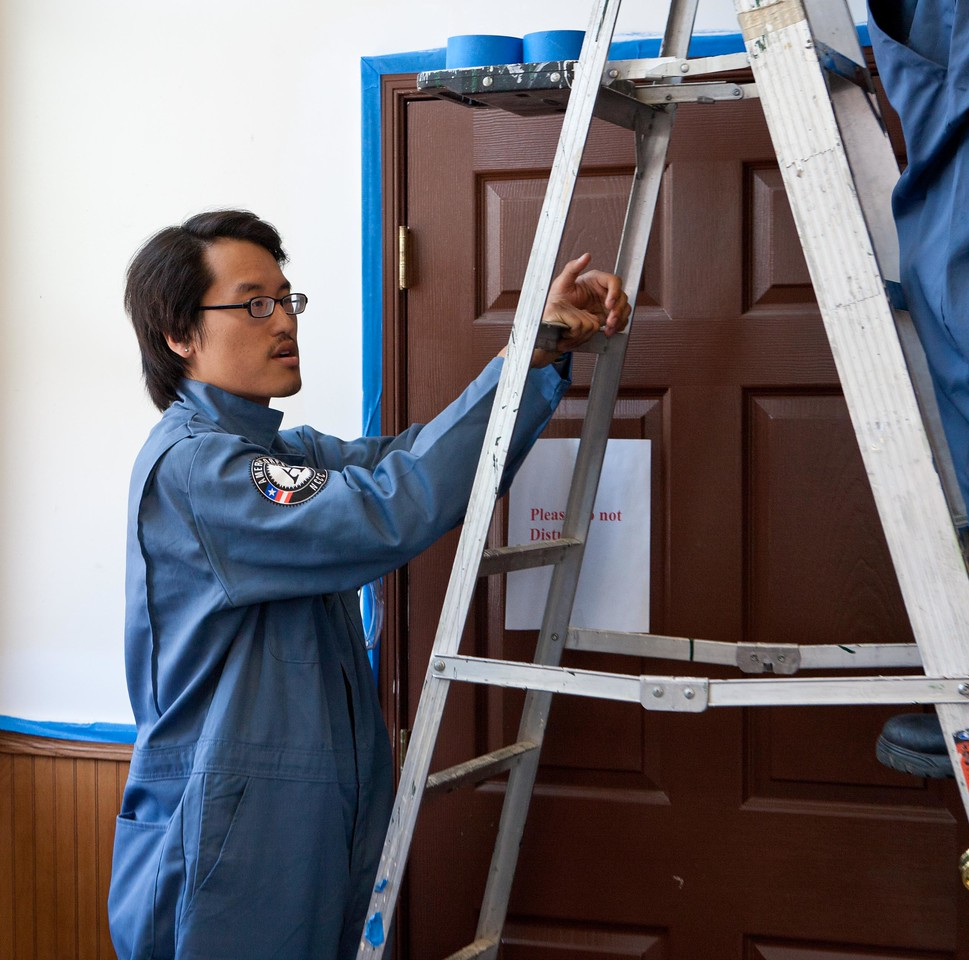 AmeriCorps members paint at a West Baltimore Police precinct at the Service Bowl in Baltimore, MD. Corporation for National and Community Service Photo.