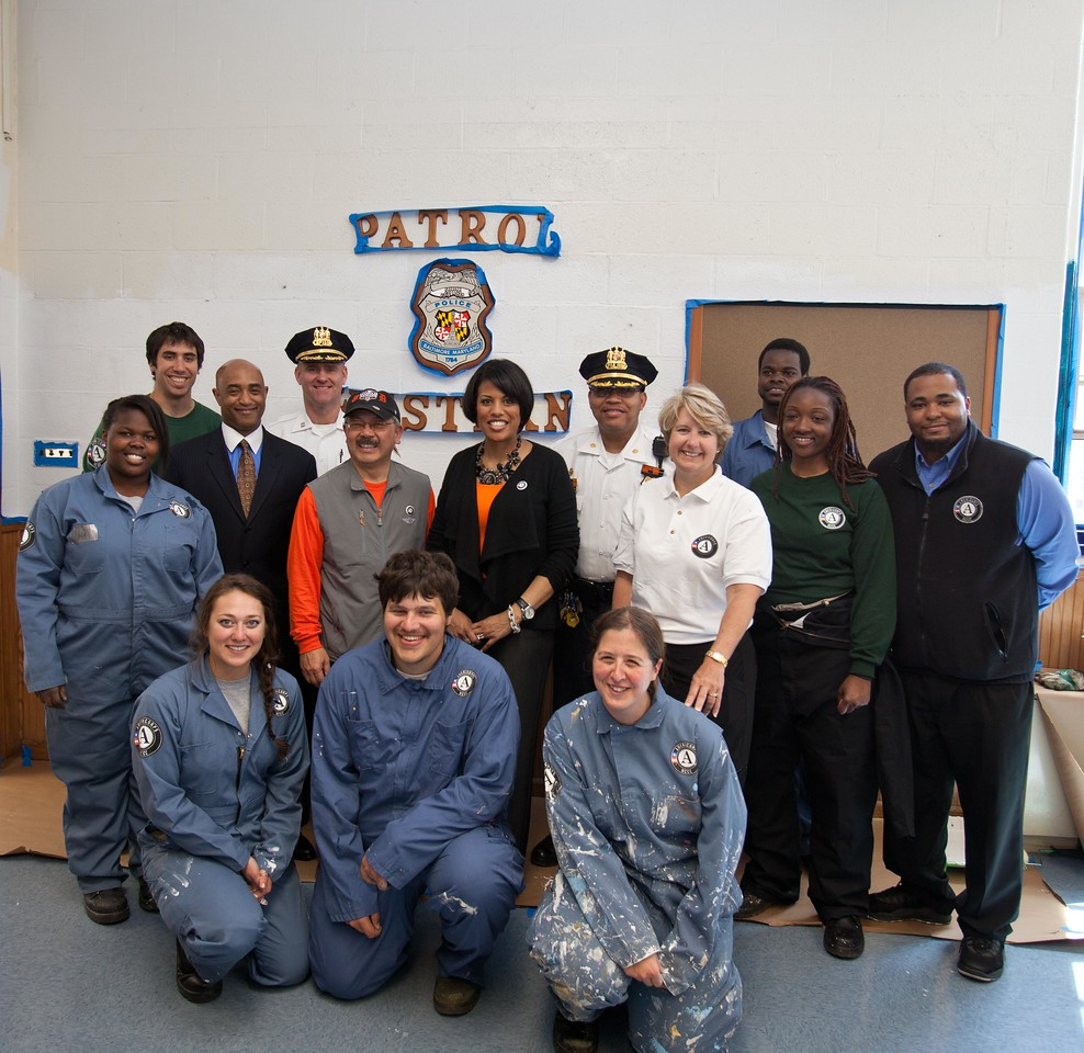 San Francisco Mayor Edwin M. Lee, Baltimore Mayor Stephanie Rawlings-Blake, and CNCS CEO Wendy Spencer pose with AmeriCorps members and police officials at a West Baltimore Police precinct at the Service Bowl in Baltimore, MD. Corporation for National and Community Service Photo.
