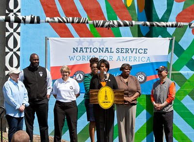 Baltimore Mayor Stephanie Rawlings-Blake speaks at the Service Bowl in Baltimore, MD, flanked by (L-R) Kate Raftery, Director of AmeriCorps NCCC; Joe Briggs of the NFL Players Association; Wendy Spencer, CEO of CNCS; and San Francisco Mayor Edwin M. Lee. Corporation for National and Community Service Photo.