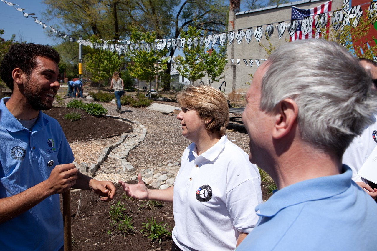 CNCS CEO Wendy Spencer talks with an AmeriCorps member at the Service Bowl in Baltimore, MD. Corporation for National and Community Service Photo.