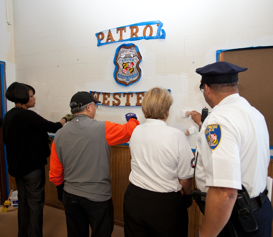 Baltimore Mayor Stephanie Rawlings-Blake, San Francisco Mayor Edwin M. Lee, and CNCS CEO Wendy Spencer paint alongside a police officer at a West Baltimore Police precinct at the Service Bowl in Baltimore, MD. Corporation for National and Community Service Photo.